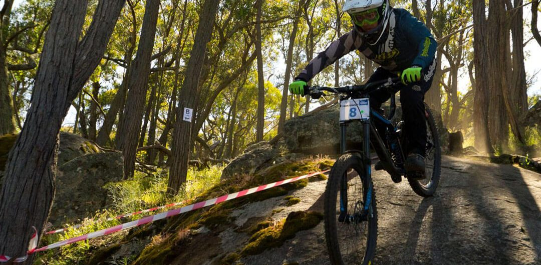 Victorian Downhill Series mountain bike rider going down rock Barjarg VDHS