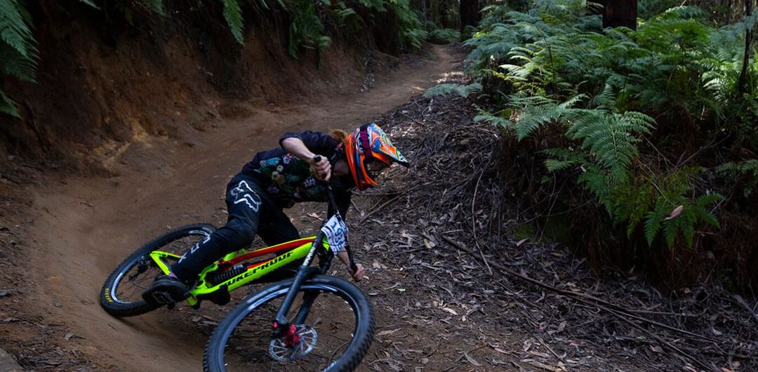 Victorian Downhill Series downhill mountain biker going around a berm at Narbethong Downhill Mountain Bike track VDHS